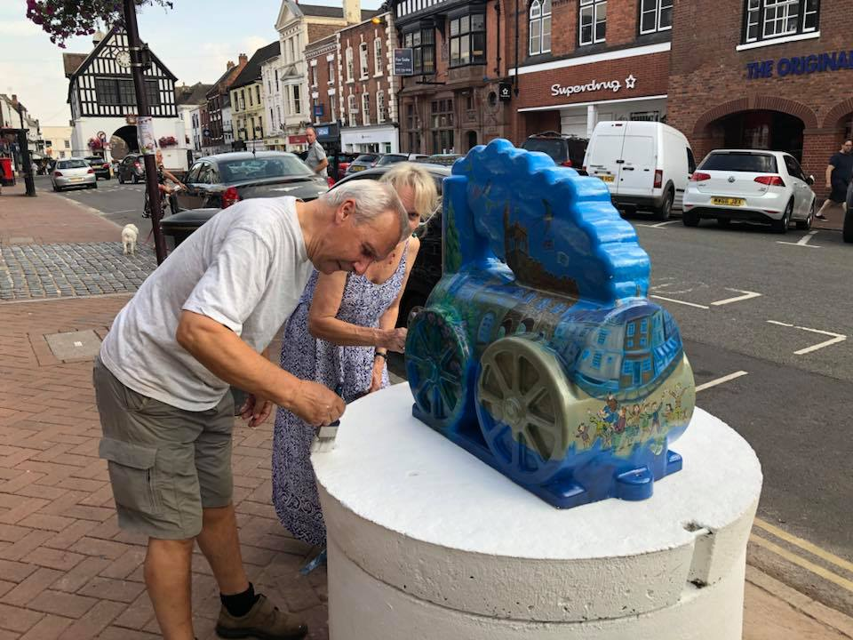 Mayor Ron Whittle and Carol Whittle touching up a statue plinth ahead of the trail launch